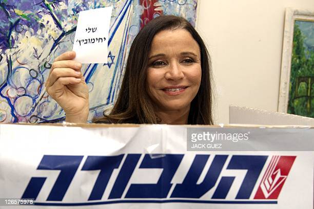 Israel's Labor party candidate and former journalist Shelly Yachimovich holds a ballot with her name before casting her vote in a fight for the...
