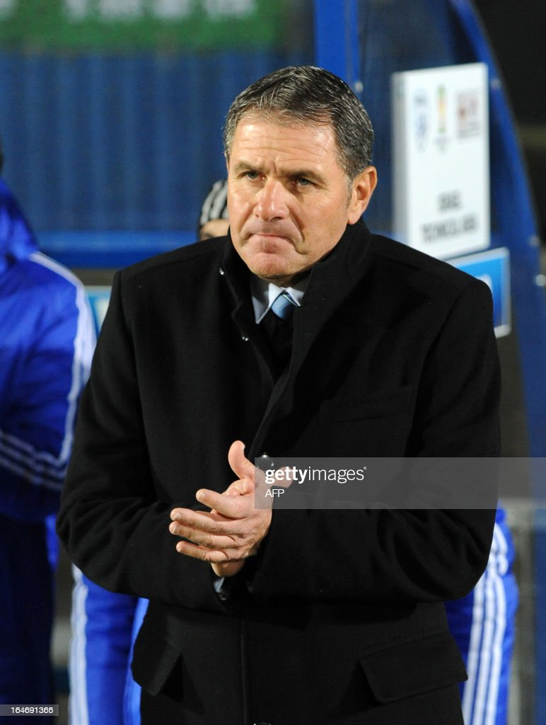 Israel's manager Eli Guttman looks on during the FIFA 2014 World Cup qualifying football match between Northern Ireland and Israel at Windsor Park in Belfast, Northern Ireland on March 26, 2013. Israel won the game 2-0. AFP PHOTO/MICHAEL COOPER