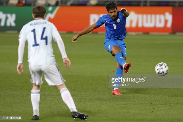 Israel's midfielder Dor Peretz shoots to score during the 2022 FIFA World Cup qualifier group F football match between Israel and Scotland at...