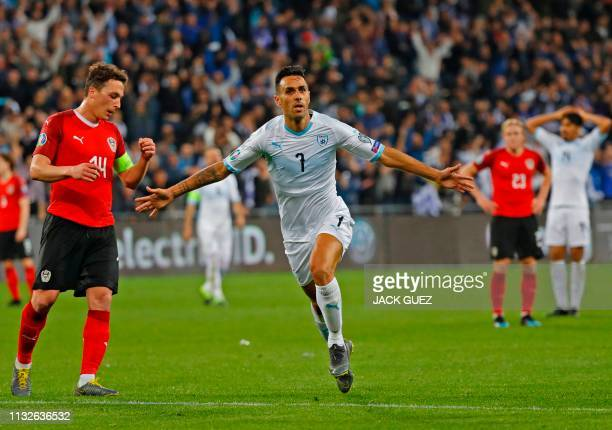 Israel's midfielder Eran Zahavi celebrates after scoring his hat trick during the Euro 2020 Group G football qualification match between Israel and...