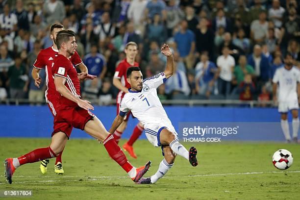 Israel's midfielder Eran Zahavi passes the ball as Liechtenstein's midfielder Sandro Wieser defends during the World Cup 2018 qualification football...