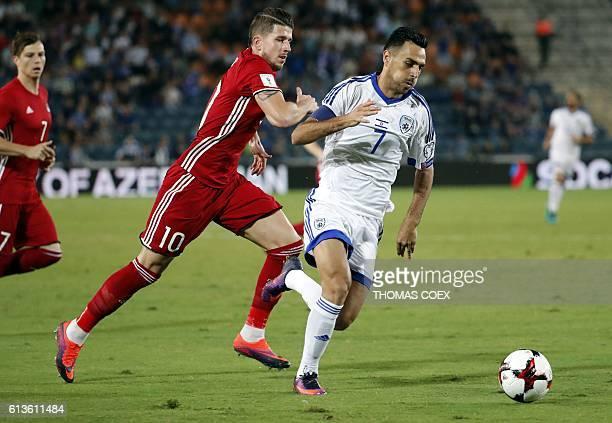 Israel's midfielder Eran Zahavi vies for the ball against Liechtenstein's midfielder Sandro Wieser during the World Cup 2018 qualification football...