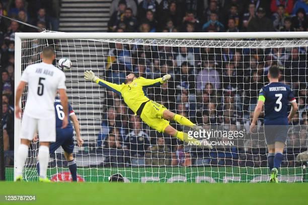 Israel's midfielder Eran Zehavy scores his team's opening goal past Scotland's goalkeeper Craig Gordon during the FIFA World Cup Qatar 2022 Group F...