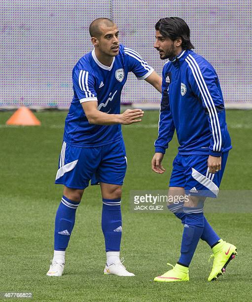 Israels midfielders Lior Refaelov and Tal Ben Haim take part in a training session at the Sammy Ofer Stadium in the Israeli coastal city of Haifa, on...