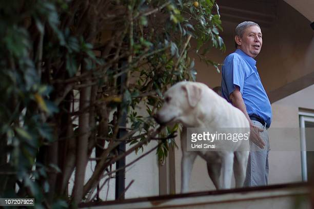 Israel's new Mossad chief Tamir Pardo poses for photographs out side his house on November 30, 2010 in Nirit, Israel. Pardo was named the new...