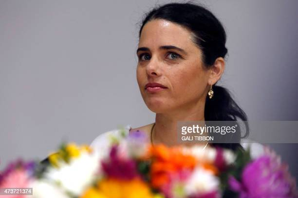 Israel's newlyappointed Justice Minister Ayelet Shaked looks on during a ceremony welcoming her at the Justice Ministry on May 17 2015 in Jerusalem...