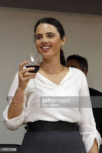 Israel's newlyappointed Justice Minister Ayelet Shaked raises a toast during a ceremony welcoming her at the Justice Ministry on May 17 2015 in...