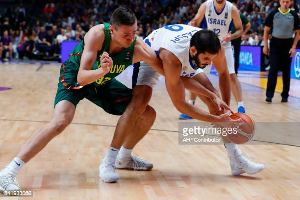 Israel's Omri Casspi vies for the ball with Lithuania's Edgaras Ulanovas during the FIBA EuroBasket championship basketball match between Israel and...