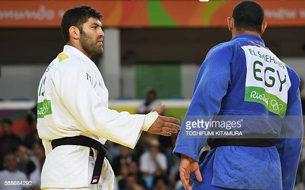 TOPSHOT Israel's Or Sasson competes with Egypt's Islam Elshehaby during their men's 100kg judo contest match of the Rio 2016 Olympic Games in Rio de...