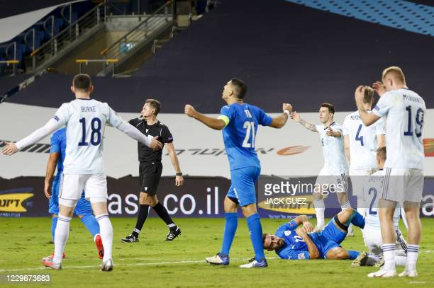 Israel's players celebrate as the referee blows the final whistle during the UEFA Nations League B Group 2 football match between Israel and Scotland...