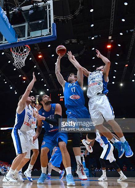 Israel's point guard Gal Mekel and Israel's point guard Yogev Ohayon defend against Italy's power forward Nicolo Melli during the round of 16...