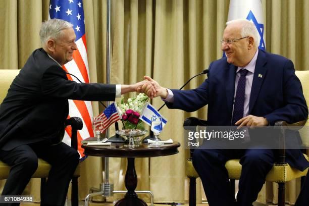 Israel's President Reuven Rivlin shakes hands with US Defense Secretary James Mattis on April 21 2017 in Jerusalem Israel