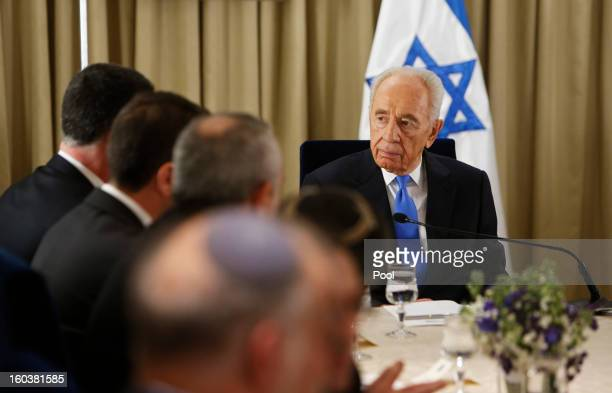 Israel's President Shimon Peres meets with representatives of Israeli Prime Minister Benjamin Netanyahu's Likud-Beitenu party on January 30, 2013 in...