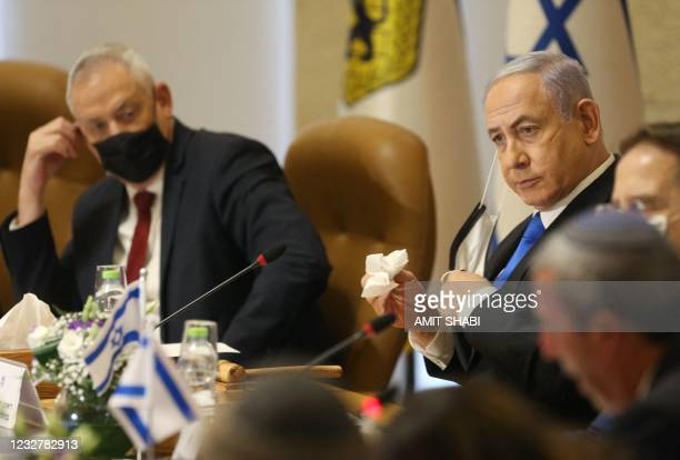 Israel's Prime Minister Benjamin Netanyahu and Defence Minister Benny Gantz , both wearing masks for protection against the COVID-19 pandemic, attend...