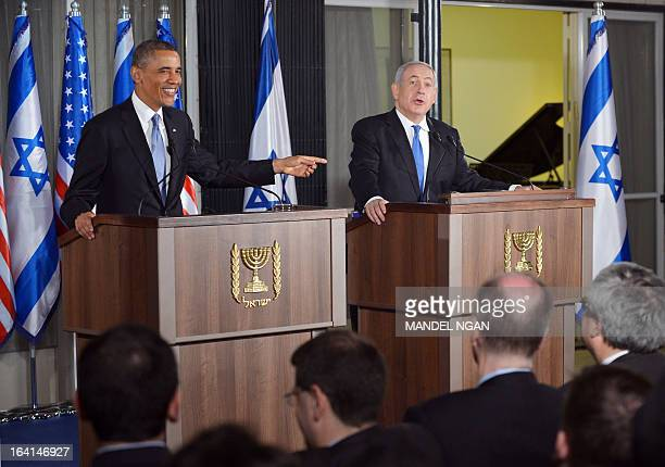 Israel's Prime Minister Benjamin Netanyahu and US President Barack Obama react to a question from the press during a joint press conference following...