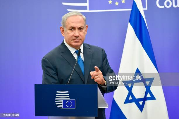Israel's Prime Minister Benjamin Netanyahu gestures as he speaks during a joint press conference with the EU foreign policy chief, at the European...