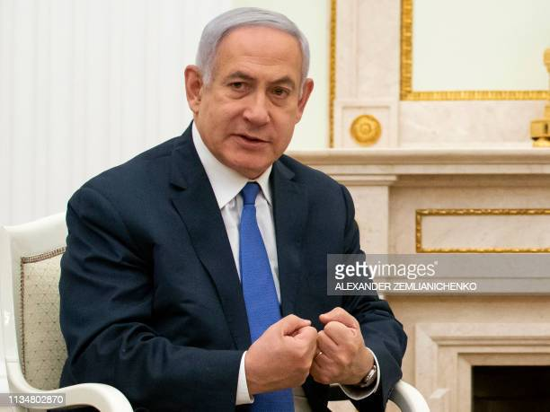 Israel's Prime Minister Benjamin Netanyahu gestures as he speaks with Russian President during their meeting at the Kremlin in Moscow on April 4 2019