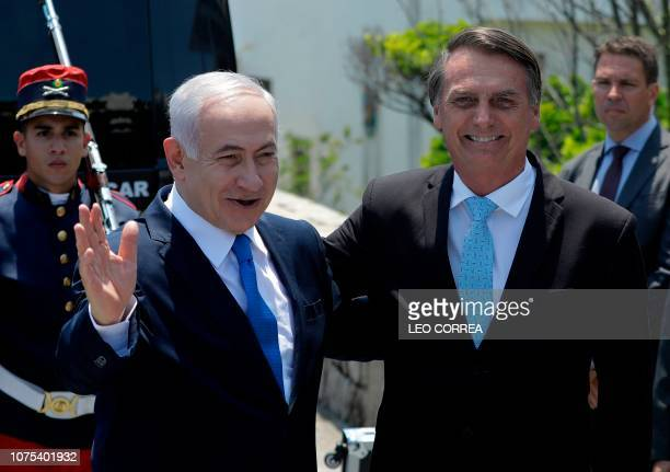 Israel's Prime Minister Benjamin Netanyahu is welcomed by Brazil's Presidentelect Jair Bolsonaro at the Copacabana fort in Rio de Janeiro Brazil on...
