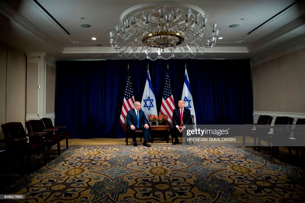 Israel's Prime Minister Benjamin Netanyahu (L) listens while US President Donald Trump makes a statement for the press before a meeting at the Palace Hotel during the 72nd session of the United Nations General Assembly on September 18, 2017, in New York. / AFP PHOTO / Brendan Smialowski