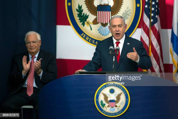 Israel's Prime Minister Benjamin Netanyahu speaks on stage as US ambassador to Israel David Friedman claps during the opening of the US embassy in...