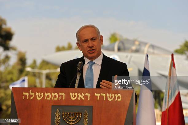 Israel's Prime Minister Benjamin Netanyahu speaks to the press after meeting released Israeli soldier Gilad Shalit on October 18, 2011 in Tel Nof Air...