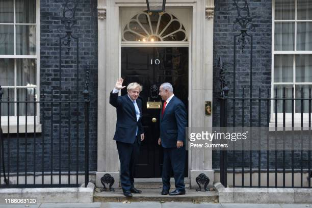 Israel's Prime Minister Benjamin Netanyahu waves to the press as he meets with Prime Minister Boris Johnson at 10 Downing Street on September 5 2019...