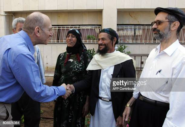 Israel's Prime Minister Ehud Olmert greets immigrants prior to an immigration conference in the southern Israeli city of Ashdod 16 October 2007...