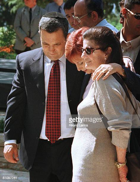 Israel's Prime Minister Elect Ehud Barak And His Wife Nava Embraces Leah Rabin , While Visiting The Grave Of Her Husband, Assassinated Prime Minister...