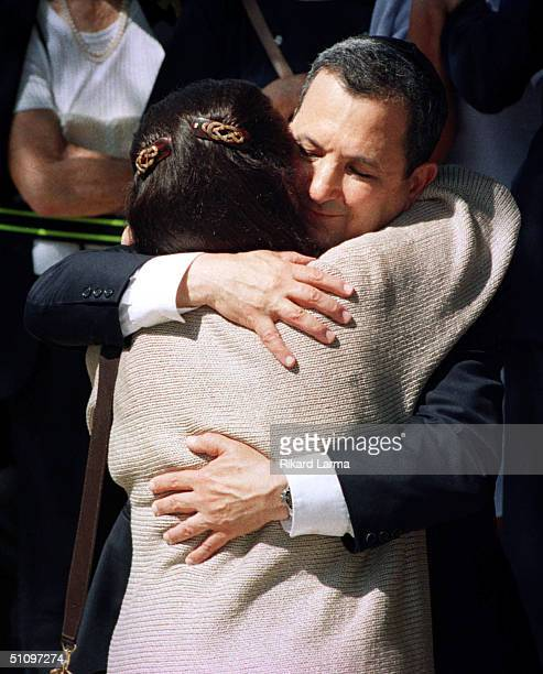 Israel's Prime Minister Elect Ehud Barak Hugs Leah Rabin, Widow Of Israeli Prime Minister Yitzhak Rabin, While Visiting The Grave Of The Assassinated...