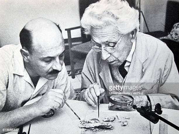 Israel's Professor yigal yadin and james biberkraut study samples from the dead sea scrolls 1965