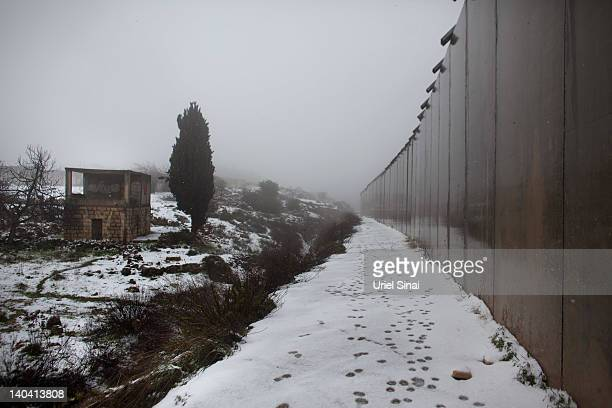 Israel's separation barrier as snow falls on March 2 2012 near Hebron West Bank This is the first time in four years that Hebron has experienced snow...