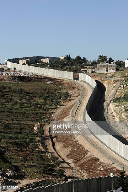Israel's separation barrier is seen January 8 2005 in Abu Dis West Bank Mahmoud Abbas is favorite to replace the late Yasser Arafat when Palestinians...