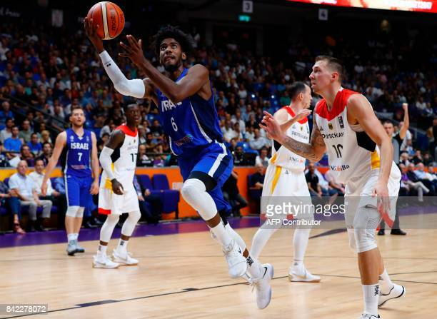 Israel's Shawn Dawson shoots the ball next to Germany's Daniel Theis during the FIBA EuroBasket 2017 basketball match between Israel and Germany at...