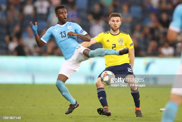 Israel's Taleb Tawatha and Scotland's Stephen O'Donnell battle for the ball during the UEFA Nations League Group C1 match at the Sammy Ofer Stadium,...