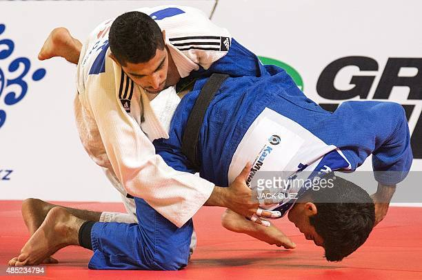 Israel's Tohar Butbul fights against Puerto Rico's Adrian Gandia during the mens qualification match in the 73kg category at the the IJF Judo World...