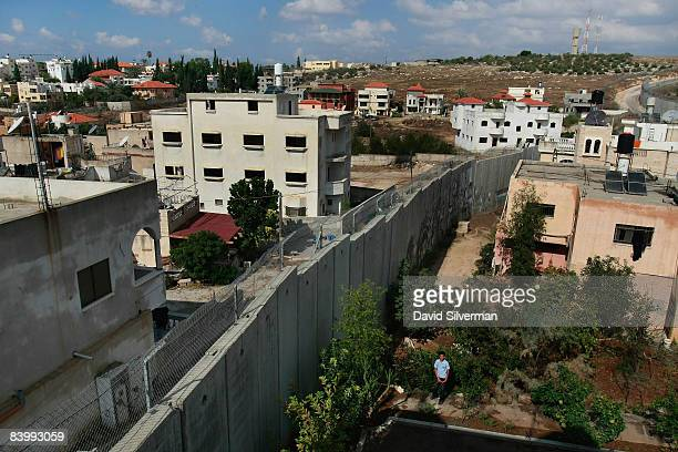 Israel's West Bank separation barrier cuts between the Palestinian village of Nazlat Issa at right and the Israeli Arab village of Baqa alGharbiya...