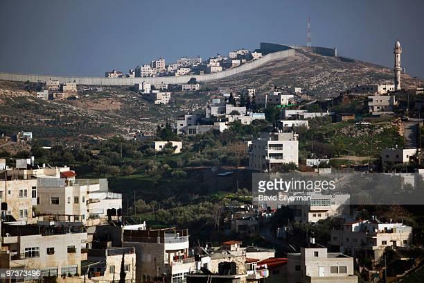 Israel's West Bank separation barrier is seen on March 2, 2010 at the far end of the East Jerusalem neighborhood of Silwan. Jerusalem Mayor Nir...