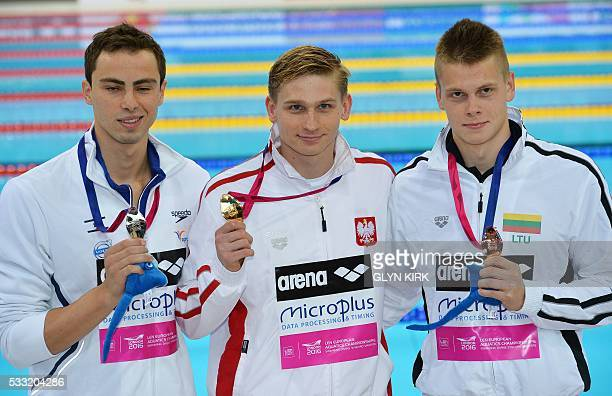 Israel's Yakov Yan Toumarkin Poland's Radoslaw Kawecki and Lithuania's Danas Rapsys pose with their medals after winning silver gold and bronze...