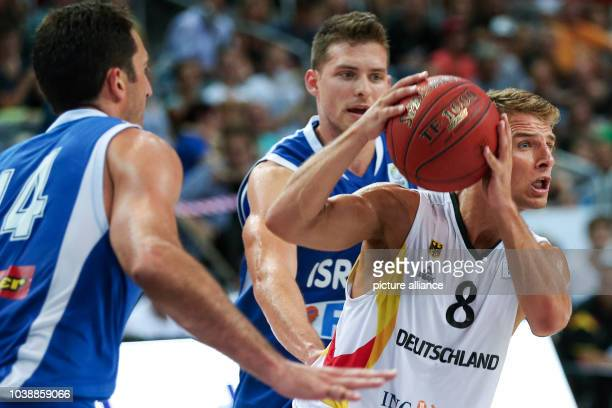 Israel's Yaniv Green and Gal Mekel and Germany's Heiko Schaffartzik in action during the basketball DBB Supercup 2014 match between Germany and...
