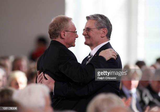 Israli author and prize winner David Grossmann and laudator Joachim Gauck embrace during the donation ceremony for the peace prize of the German...