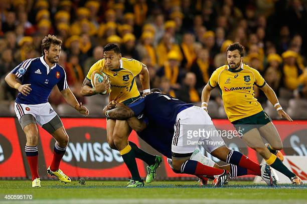 Isreal Folau of the Wallabies runs with the ball during the second International Test Match between the Australian Wallabies and France at Etihad...
