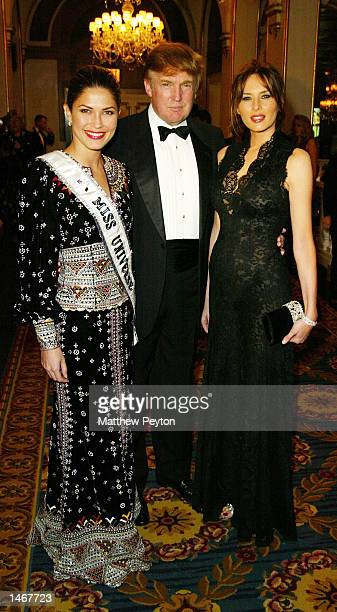 iss Universe Juntine Pasek Donald Trump and Malanie Knauss pose attend the 2002 USO of Metropolitan New York Gold Medal Awards at The Plaza Hotel...
