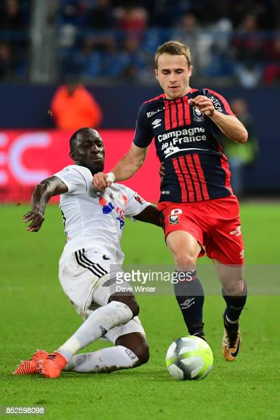 Issa Cissokho of Amiens and Jan Repas of Caen during the Ligue 1 match between SM Caen and Amiens SC at Stade Michel D'Ornano on September 23 2017 in...
