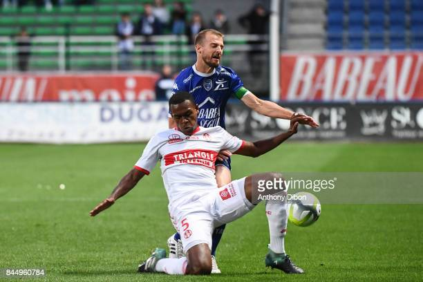 Issa DIOP of Toulouse and Stephane Darbion of Troyes during the Ligue 1 match between ESTAC Troyes and FC Toulouse at Stade de l'Aube on September 9...