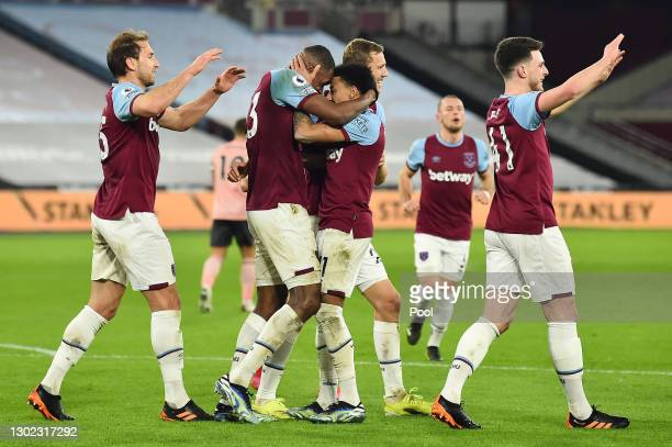 Issa Diop of West Ham celebrates with teammates after scoring their team's second goal during the Premier League match between West Ham United and...