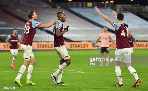 Issa Diop of West Ham celebrates with teammates Tomas Soucek and Declan Rice after scoring their team's second goal during the Premier League match...