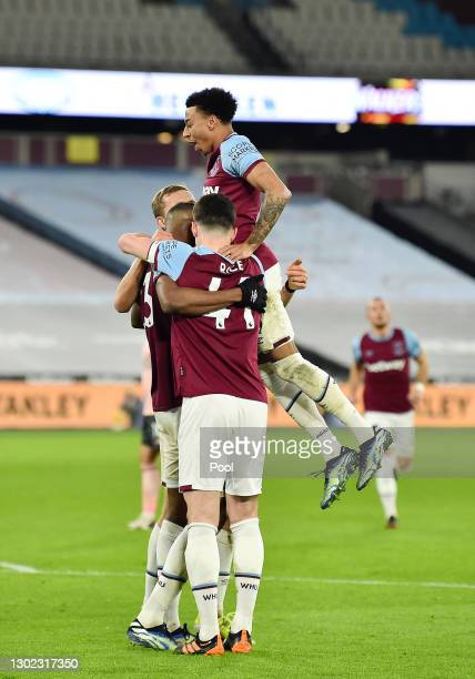 Issa Diop of West Ham celebrates with teammates Tomas Soucek , Declan Rice and Jesse Lingard after scoring their team's second goal during the...