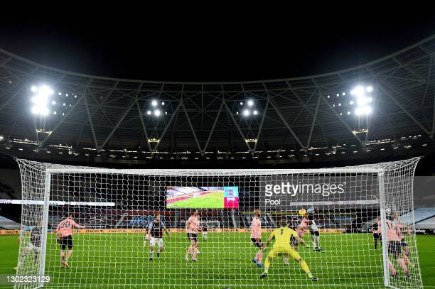 Issa Diop of West Ham scores their team's second goal past Aaron Ramsdale of Sheffield United during the Premier League match between West Ham United...