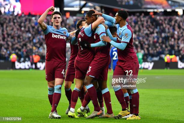 Issa Diop of West Ham United celebrates scoring a goal to make the score 1-0 with his team-mates during the Premier League match between West Ham...