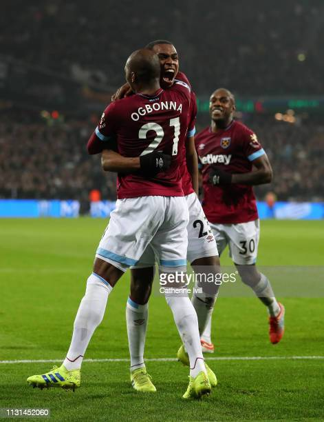 Issa Diop of West Ham United celebrates with Angelo Ogbonna of West Ham United after scoring his side's second goal during the Premier League match...